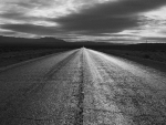 asphalt road through desert in monochrome