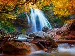 Forest waterfall in autumn