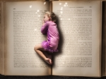 Little girl sleeping in book