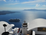 cruise ship passing by santorini island