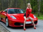Model Posing with a Red Ferrari