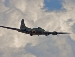 boeing b17 flying fortress in the clouds