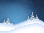 white glowing christmas tree on the snowy hills