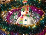 Snowman in tinsel