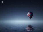 hot air balloon over sea at night