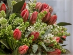 Bouquet of red tulips and white lilac