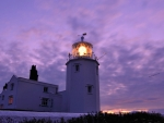 lighthouse under lavender sky