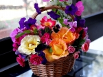 Basket with colorful flowers