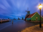 windmills in a holland town at twilight