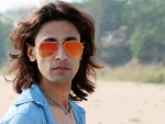 Super handsome Rajkumar patra looking in red sunglass
