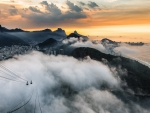 rio de janeiro covered by clouds at sunrise