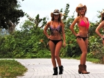Cowgirls On A Beach Walkway..