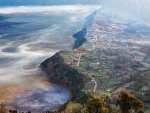magnificent aerial panorama of towns and fields under fog
