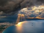 heavenly sunbeams over seaside city