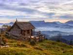 little wood cabin on a mountaintop in austria hdr