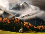 beautiful little church infront of italian mountains in fall