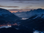 panorama of towns and lakes in a swiss alpine valley