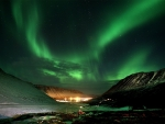 northern lights over village
