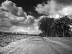 clouds over a country road in monochrome