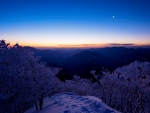 moon over mountain panorama at dusk