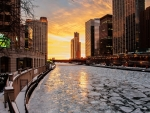 frozen chicago river at sunset