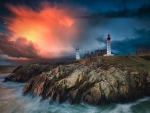 lighthouse on a rocky point under gorgeous sky hdr