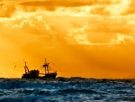 fishing boat under yellow sky