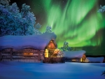 log cabins in winter under aurora borealis hdr
