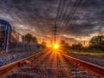 awesome sunset over train tracks hdr