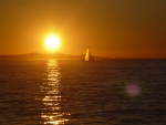 sunset with sailboat