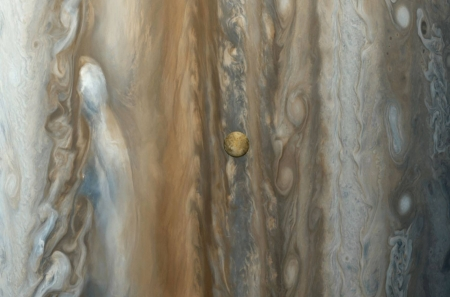 Io over Jupiter from Voyager - space, cool, moon, jupiter, planet, io, fun