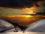 Snowy Mountainside Landscape at Sunset