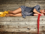 Cowgirl Napping In A Barn..