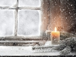 Christmas Candle in the Snow