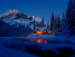Cottage in winter mountain