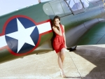 Model Posing with a Vintage WW2 Plane