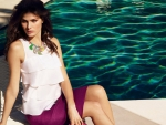 Isabeli Fontana Sitting near the Pool