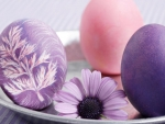 Easter eggs and purple flowers