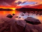 Fiery sunset over mountain lake