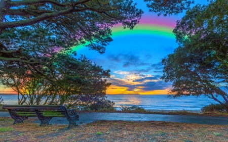 England Coast Rainbow - sidewalk, rainbow, sunset, clouds, England coast, coast, trees, England, walkway, bench