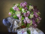 Cat and a bouquet of lilac