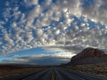 Desert Clouds over Open Road