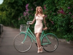 Pretty Woman Posing with her Bicycle