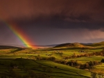 Rainbow Over Green Landscape