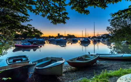 Evening river - blue, reflex, sun rays, bright, nice, sailboats, sunset, awesome, brightness, mirror, sunbeam, boats, green, trees, sky, leaf, surface, sand, personal boats, dawn, sunshine, harbor, reflections, scenery, evening, amazing, orange, scenic, scenario, cool, morning, riverscape, pier, marina, beautiful, river, scene