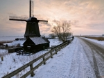 Old Windmill on a Snowy Field