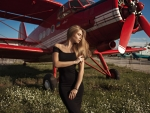Model Posing with a Airplane