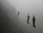Walking the Via Ferrata in a slate mine in north west England during a foggy day
