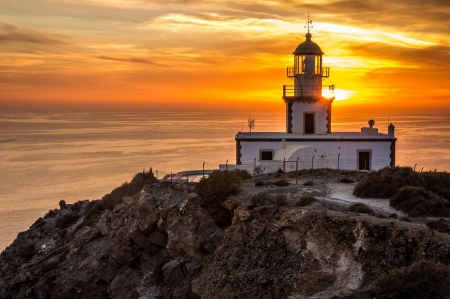 Lighthouse During Sunset - sky, lighthouse, sunset, clouds, sea, outdoor nature