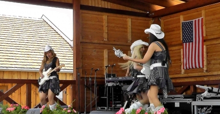 Cowgirl On Stage . . - western, guitar, style, cowgirl, hats, women, ranch, boots, music, outdoors, girls, female, brunettes, fun
